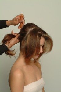 Hair being pulled into a ponytail