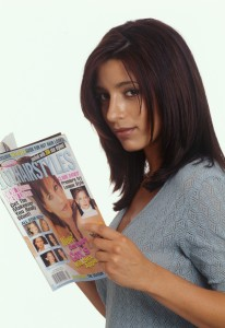 Girl reading Hairstyles magazine
