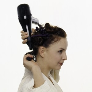 Girl blowdrying her hair