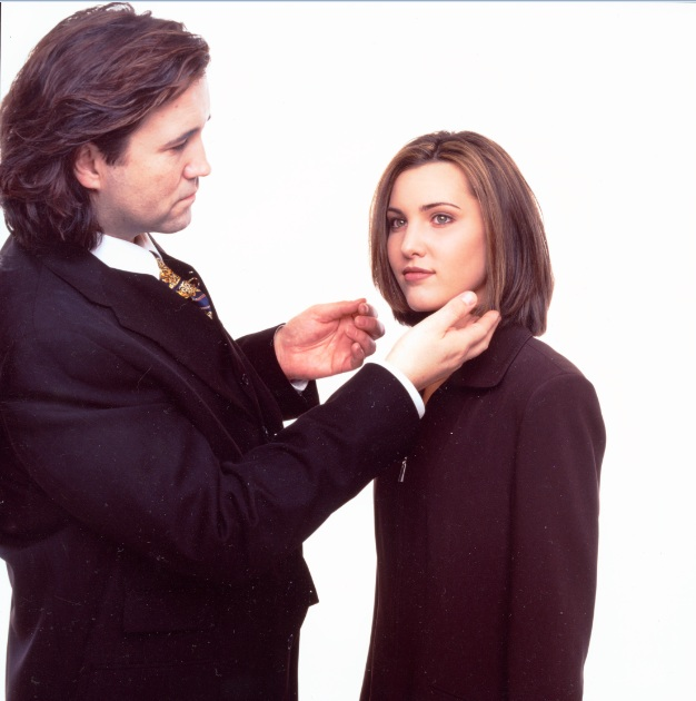 Hair being touched-up by stylist
