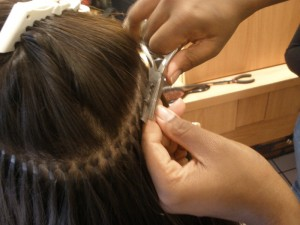 Hair extensions being added